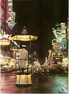 Hong Kong in 60's. - Mong Kok  (瓊華酒樓 on the right,新雅大酒樓 on the nearer left.)