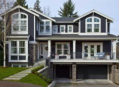 beautiful house plan for sloping lot.  needs one more bedroom upstairs.  great open main level.