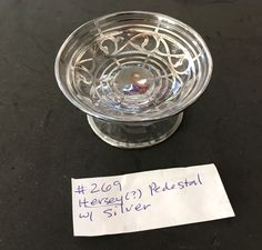 Glass Salt with silver stripes and design on a pedestal. Hersey? I sometimes can't tell what my Mom wrote!