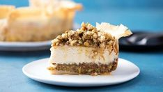 Recipe with video instructions: Made with a phyllo dough and pistachio crust, this creamy, honeyed baklava cheesecake incorporates the best of both desserts. Ingredients: For the crust:, 12 sheets phyllo dough, 12 tablespoons butter, divided and melted, 2 cups pistachios, 2 cups walnuts, Pinch salt, For the cheesecake:, 3 cups cream cheese, softened, 1/2 cup honey, 3 large eggs, 2 teaspoons vanilla, 1 teaspoon lemon juice, For the topping:, 1 cup honey, 1/2 cup water, 1 teaspoon ora...
