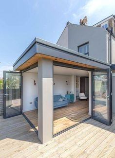 oak Garden room Oak patio doors are not your only external patio doors option, there is so much . Flat Roof Design, House Extension Design, Glass Extension, Extension Ideas, Kitchen Extension Flat Roof, Extension Google, Garden Room Extensions, House Extensions, Parrilla Exterior