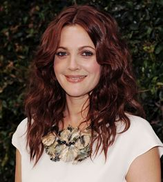 Beachy waves look great with just about any color, but something about rich burgundy looks especially dynamic with this shaggy, sexy texture. To get it, simply curl your hair with a medium size barrel curling iron, then add a little texturizer to your fingertips and muss it up.  - GoodHousekeeping.com