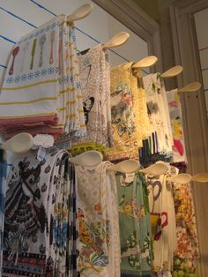 Hand towels on racks made of wooden spoons - reason this works so well is due to the link between the product and the display item.