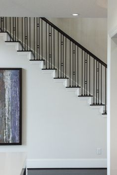 This staircase uses high quality wrought iron balusters to create a unique craftsman style design. Featured is the double bar square baluster (16.6.1) and the plain square bar (16.2.1). These balusters are stocked in hollow or solid wrought iron, and are available in a Satin Black or Ash Grey powder-coated finish. These balusters are paired with industry standard wood components. We supply a variety of stock parts, custom material, and exotic wood. Click the image for more information.