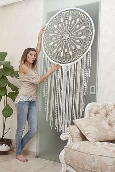 Large crochet dreamcatcher. An Indian talisman made as a luxurious bohemian bedroom wall hanging decoration that protects the sleeper from evil spirits. Bad dreams get tangled in the web, while good ones slip through the hole in the middle. If you do not know what to do or are looking for an