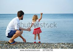 Happy father and daughter at the seaside look far away. The concept of a happy family holiday. Family Stock Photo, Father Daughter, Happy Family, Family Holiday, Happy Father, Far Away, Seaside, Photo Editing, Royalty Free Stock Photos