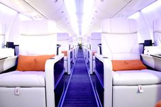 """Four Seasons Private Jet seats are designed by Iacobucci, a favorite Italian craftsman, and the seats slide smoothly and quietly from sitting upright to lying flat at a touch of a button. Tray tables are topped in dark shellacked wood, with a roomy surface that can easily handle a heavy laptop or formally set, three-course meal."""