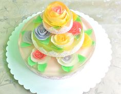 3 Tier Floral Jello Cake....not just jello www.sweetcollections.com offers all ORGANIC and subtle sweet creations.  PERFECT because others are all artificial and way too sweet!! FINALLY something beautiful to look at and beautiful for the body too!