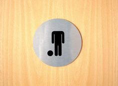 Toilet signs at Umbro HQ. Those folks live football.