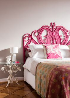 Master bedroom.  Fuchsia Pink King Peacock bed head and vintage quilt from Katie's business, The Family Love Tree.  Photos - Sean Fennessy, Styling / Production – Lucy Feagins.
