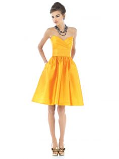 Strapless cocktail length peau de soie dress with draped bodice and pleated midriff. Full shirred skirt has pockets at side seams.