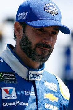 Jimmie Johnson Photos Photos - Jimmie Johnson, driver of the #48 Lowe's Chevrolet, walks through the garage area during practice for the Monster Energy NASCAR Cup Series Axalta presents the Pocono 400 at Pocono Raceway on June 9, 2017 in Long Pond, Pennsylvania. - Pocono Raceway - Day 1