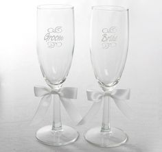 The newly married couple can make their first toast as the newly married couple with these Bride and Groom Toasting Flutes.