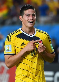 James Rodriguez Photos - James Rodriguez of Colombia celebrates scoring his team's fourth goal during the 2014 FIFA World Cup Brazil Group C match between Japan and Colombia at Arena Pantanal on June 2014 in Cuiaba, Brazil. - Japan v Colombia: Group C James Rodriguez Colombia, Fifa, Football Love, World Football, Football Icon, Soccer Stars, Soccer Boys, Good Soccer Players, Football Players