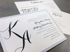 Custom wedding invitation with script initial monogram by Paperwhites (paperwhites-invitations.com) #black #silver