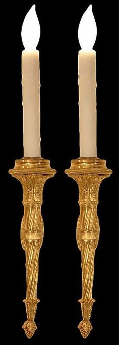 An elegant and high quality pair of French mid 19th century Louis XVI st. single arm ormolu sconces. Each has a central rosette backplate with berried laurel top and bottom finial supporting the arm. The arm extension has an acanthus leaf decorated stem, the arm with a spiral fluted fut has a bottom acorn while the candlecup above has richly chased acanthus leaves. All original gilt.