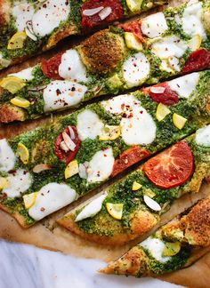 Homemade basil-almond pesto pizza with a simple whole wheat crust! I topped my pizza with heirloom tomatoes and yellow squash. Feel free to change it up! Pizza Recipes, Vegetarian Recipes, Cooking Recipes, Healthy Recipes, Delicious Recipes, Homemade Pesto Pizza Recipe, Pesto Recipe, Whole Wheat Pizza, Gastronomia