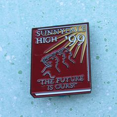 As an honorary member of the Sunnydale, CA class of 1999 you might not have gotten a physical yearbook from the school since it was blown up and had to be rebuilt. This pin can commemorate your status in the class. You might not have fought the mayor of Sunnydale but you cheered them on at home. This 1.25 enamel pin is a prefect addition to your collection. 2 Post with rubber backing