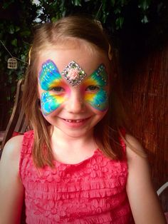 Butterfly face paint with homemade bling