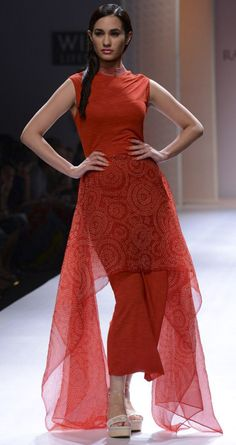 Red bandhani jersey long dress by RAHUL MISHRA. http://www.perniaspopupshop.com/wills-fashion-week/rahul-mishra #fashionweek #willslifestyleindiafashionweek