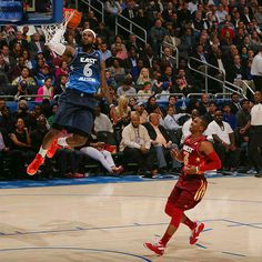 LeBron James dunks as Chris Paul watches during the 2012 NBA All-Star Game. Everyone, including LeBron, looks bored.