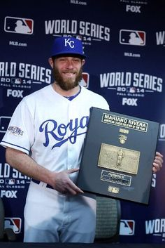 KANSAS CITY, MO - OCTOBER 22: Greg Holland #56 of the Kansas City Royals poses after winning the Mariano Rivera American League Reliever of the Year Award before Game Two of the 2014 World Series against the San Francisco Giants at Kauffman Stadium on October 22, 2014 in Kansas City, Missouri. (Photo by Ed Zurga/Getty Images)
