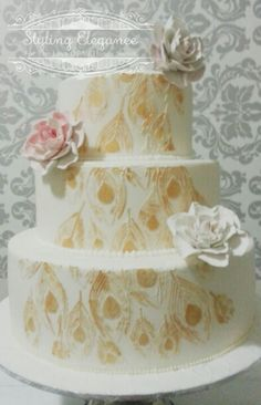 3 tier cake in ivory with hand painted gold and sugar rose accents. www.facebook.com/stylingelegance