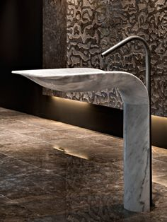 """""""The Ciuri sink by Italian company Lithea features a fluid form executed in marble, which appears as an uninterrupted curve from bowl to base."""""""