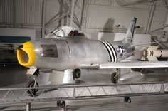 65 Years Ago Today: The Korean War began. Pictured here is one of the key aircraft from this war - the United States' first swept-wing fighter aircraft, the F-86A Sabre. Listen as F-86 pilot and Museum docent Lt. Gen. William Earl Brown describes flying the F-86 Sabre against the MiG-15 in the Korean War, and MiG-15 pilot Ken Rowe, gives his view on the two aircraft: https://www.youtube.com/watch?v=ZdAyerfTNQE&