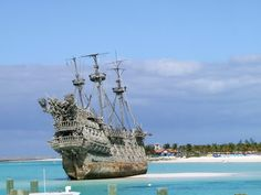 To see the real ship they used in filming The Pirates of the Caribbean shots of Davy Jones. - Castaway Cay in the Bahamas