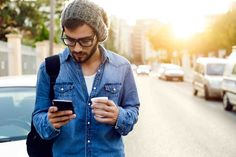 Buy Modern young man with mobile phone in the street. Outdoor portrait of modern young man with mobile phone in the street. Mobile Advertising, Mobile Marketing, Internet Marketing, App Marketing, Media Marketing, Digital Marketing, Bbc, Instagram Advertising, Outdoor Portraits