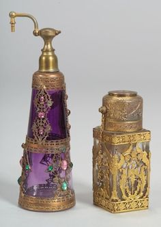 Two art glass perfume bottles. Glass with metal overlay Europe, early century Perfume Sale, Perfume Atomizer, Antique Perfume Bottles, Vintage Perfume Bottles, Perfumes Vintage, Beautiful Perfume, Bottles And Jars, Objet D'art, Carafe