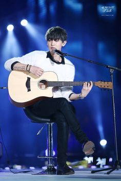 Look for the big eared, awkward, giant playing the guitar, drums or piano and singing..... Oh and talented actor...... also multi language king