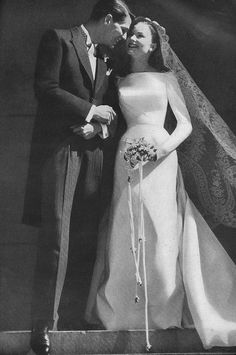 """Dressed in full honour of their wedding day - he in a cutaway, she in white, with all of the traditions: long sleeves, high neckline, a sweep of train. Dress in peau de soie (a rich reversible silk or rayon fabric) by Sophie, lace veil by Tatiana."" #vintage #wedding #bride #groom #1950s #dress"