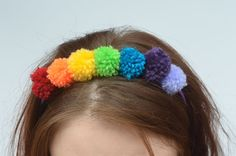 Hey, I found this really awesome Etsy listing at https://www.etsy.com/uk/listing/484014323/rainbow-pom-pom-hairband