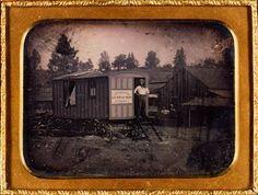 Isaac Wallace Baker in front of Batchelder's Daguerrian Saloon, California, ca 1851.