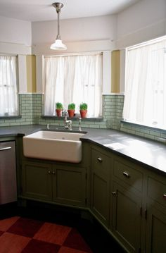 Sage-green tile with gray grout creates a unique backsplash for the new farmhouse sink.