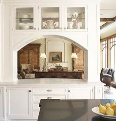 This arched opening....PASS THROUGH WITH GRANITE COUNTERTOP