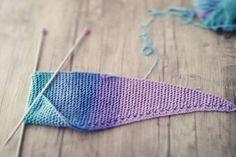 Alize cotton gold batik. Its a colorful triangular shawl