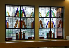 stained glass window designed with books on shelf