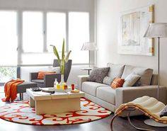 Orange implemented in a basic, neutral interior design. Love!