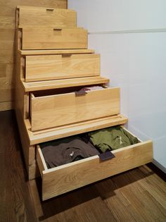 Instead of having a ladder to a loft or bunk bed, use the stairs as storage!