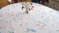 Sign (then embroider) your Thanksgiving tablecloth each year for a great keepsake and wonderful new tradition.