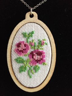 Handmade elegant cross stitch necklace with detailed rose pattern. I can adjust the length of the chain if you like. Let me know if you have any question