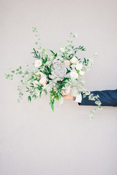 Succulent and rose bouquet, photo by Angel He Photography http://ruffledblog.com/tampa-modern-wedding-ideas #flowers #weddingbouquet
