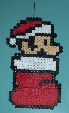 This is a large Christmas Mario perler bead ornament. Its about 5.5 inches long, so not recommended for tiny trees.    *This is a custom made