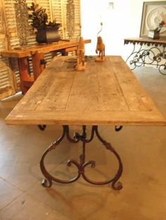 SCROLL BASED TABLE WITH RECYCLED TEAK TOP