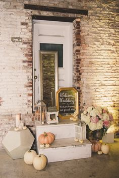 The vibe your pumpkin decorations give off depends entirely on what you pair them with. Here, muted pumpkins were mixed with flowers, lanterns, a mirror, and a geometric side table.