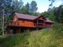 SOLD! Like New Square Log Home near Bancroft has cathedral ceiling, large deck, attached and detached garages, large lot.
