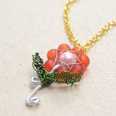 By using 7 frosted acrylic beads, 1 glass pearl bead and inches of wire, you can create your own rose pendant for the coming Valentine's Day